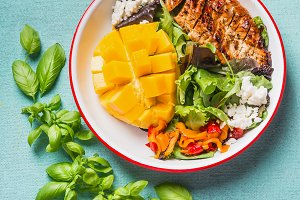 Chicken salad bowl with mango