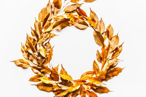 Gold autumn leaves wreath on white