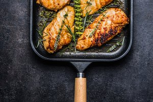 Roasted chicken breast in grill pan