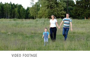 Mother, father and son walking