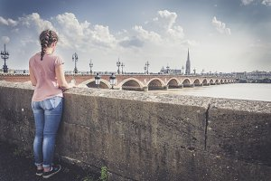 Girl looking at Bordeaux