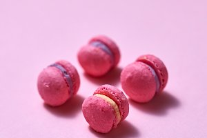 pink mini macarons on pink paper