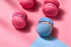 A french sweet macaroons on a blue