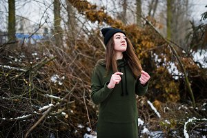 Young girl wear on long green sweats