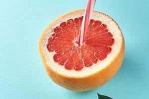 Grapefruit slice with straw on