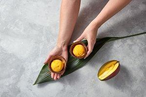 Woman hands holding natural mango