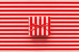 Christmas gift box on wrapping paper