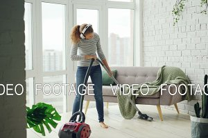 Beautiful woman is hoovering the