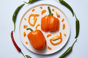 Plate with sliced colored peppers on