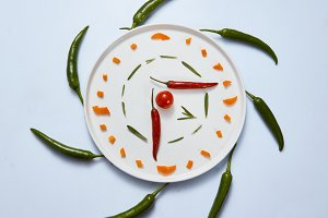 clock made from chopped chillies and