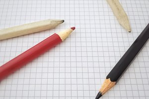 Pencils on a blank sheet