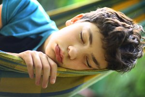 teenager boy sleeping close up photo