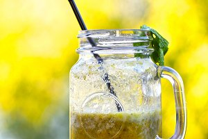 fresh lemon shoothie in jar with