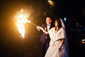 Wedding couple light fire heart  of