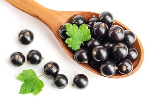black currant with leaf in wooden