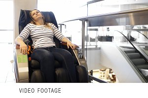 Woman having a rest in massage chair