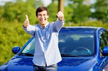 Guy with car key shows thumb up