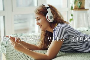 Cute young woman is listening to
