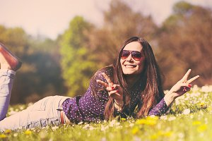 Girl lying down on grass