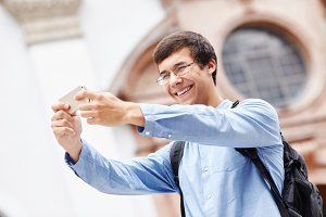 Smiling guy taking picture