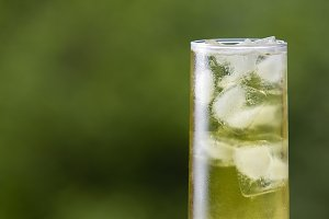 Green tea with ice in a tall glass