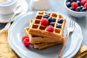 Belgian waffles served with berries