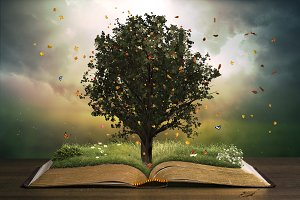 Tree with grass on an open book