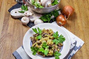Fresh champignon mushrooms on wooden