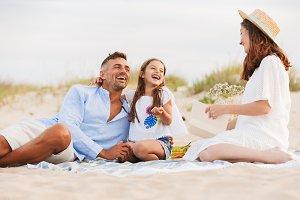 joyful family on the beach