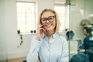 Smiling young businesswoman talking