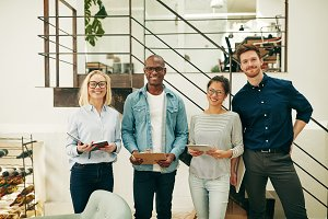 Diverse businesspeople smiling while