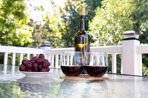 Red wine in glasses on outdoor table