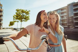 Carefree female friends walking with