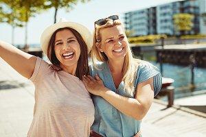 Carefree female friends having fun w