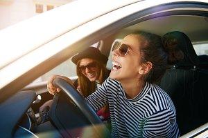 Carefree young friends driving toget