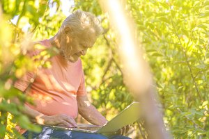 retired pensioner using modern techn