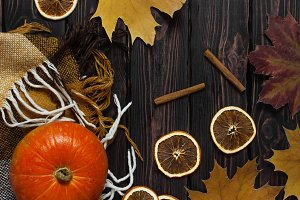 Orange pumpkin, cinnamon, leaves