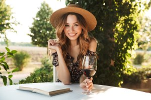 Pretty young woman drinking wine.