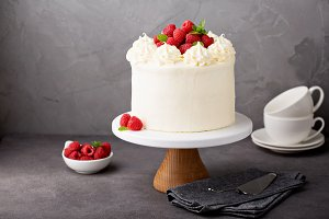 Vanilla raspberry cake with white fr