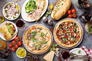 Big dinner with pizza and sandwiches