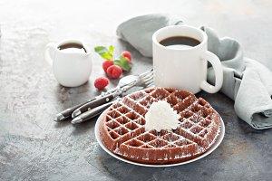 Red velvet waffles with whipped crea