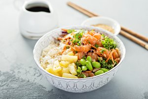 Poke bowl with raw salmon, rice and