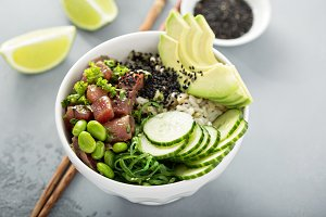 Poke bowl with raw tuna, rice and ve