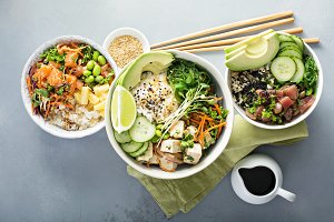 Variety of poke bowls with tuna, sal