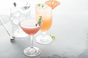 Variety of citrus cocktails on gray