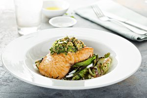 Grilled salmon on the bed of sauteed