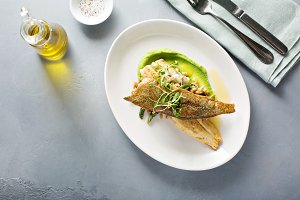Gourmet grilled trout with crisped s