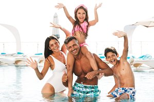 Happy young family having fun inside