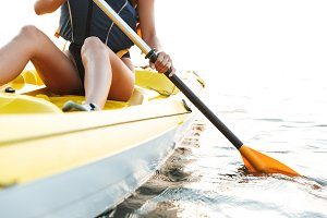 Young woman kayaking on lake sea in