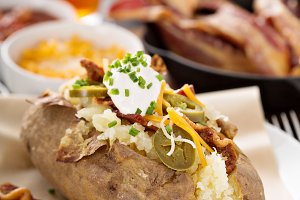 Loaded baked potato with bacon and c
